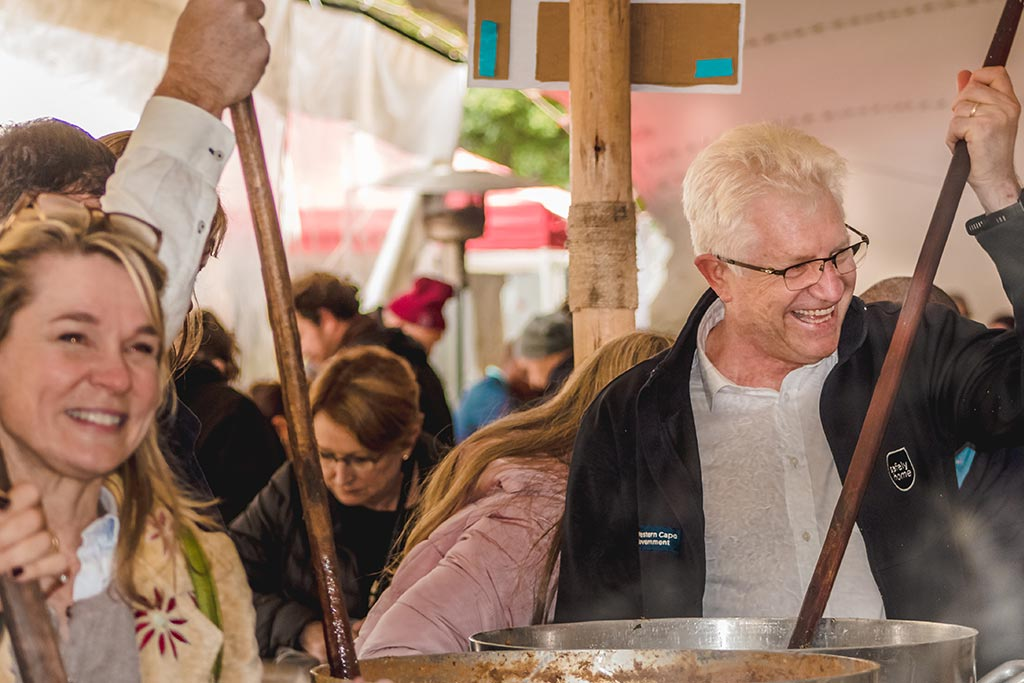 Cape Town Premier, Alan Winde, stirs soup with other volunteers on Mandela Day 2019