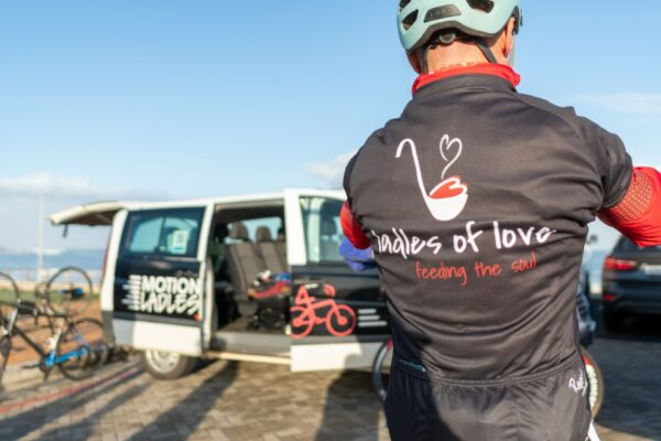 Cyclist takes a break from the fundraising cycle by the Motion4Ladles van