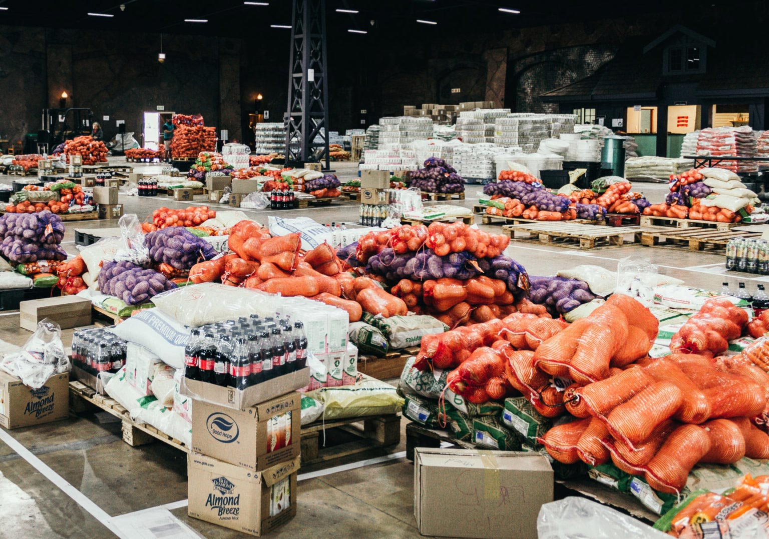 Sun International GrandWest warehouse floor covered with pallets of vegetables, soft drinks and produce