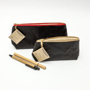 Two stylish black pencils bags made from upcycled plastic with different zip lining colours which are perfect for school.