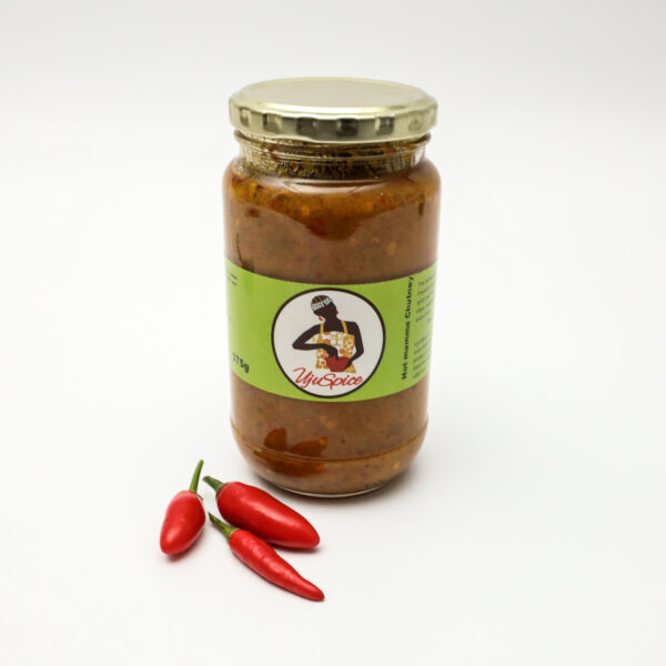 A jar of Spicy chilli chutney from Ujuspice with a green label showing a woman wearing yellow and making hot chutney in a bowl