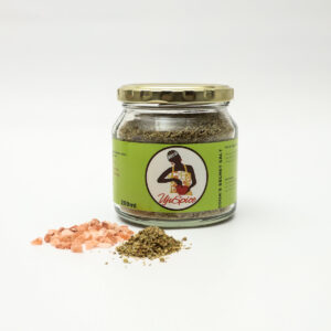 A jar of The Ujuspice Cook's Seasoning Salt is made from a secret blend of Herbs with a green label of a woman in traditional African clothing.