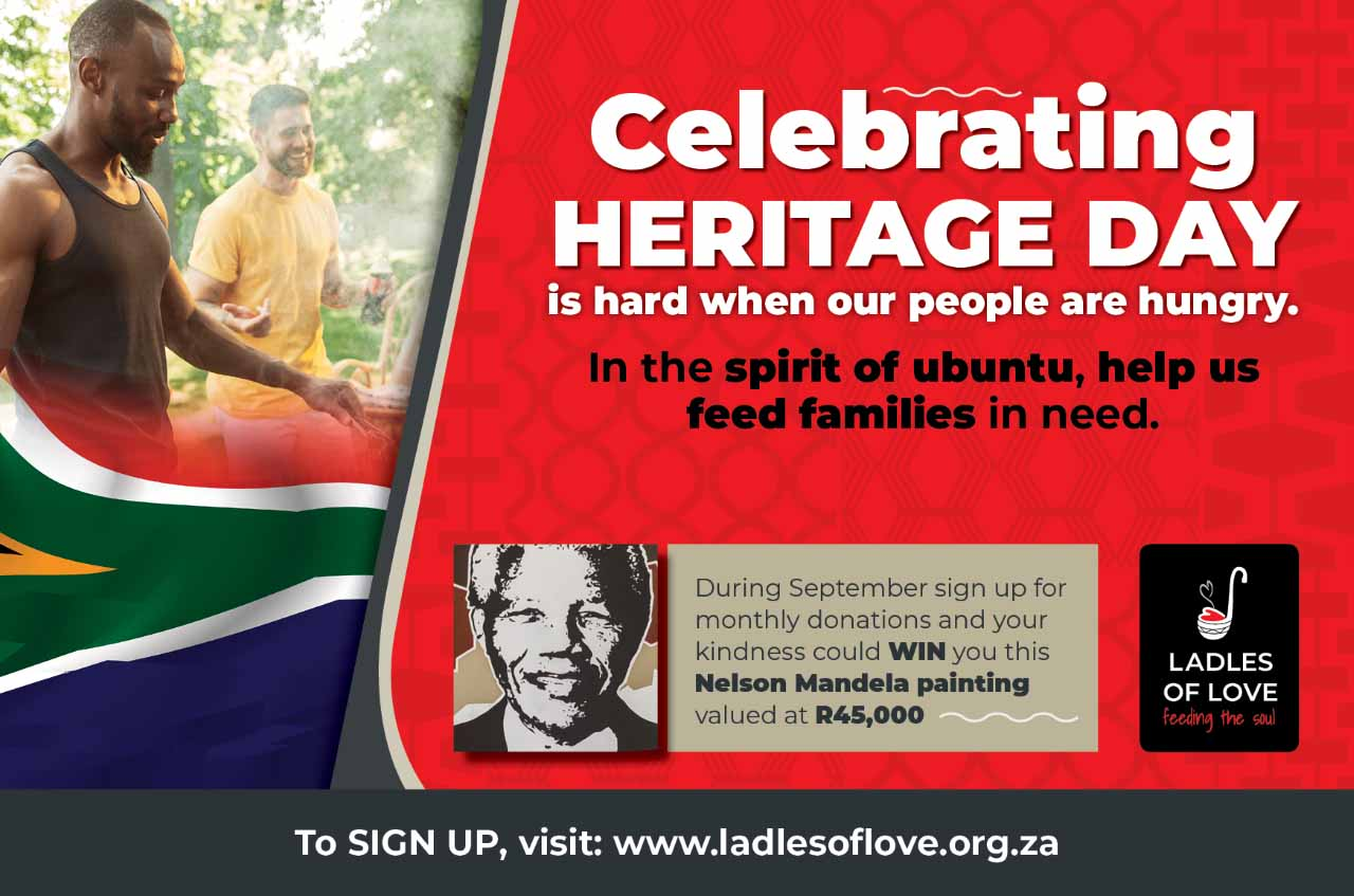 an image of south African men celebrating heritage day with a south African flag and having a braai to help ladles of love